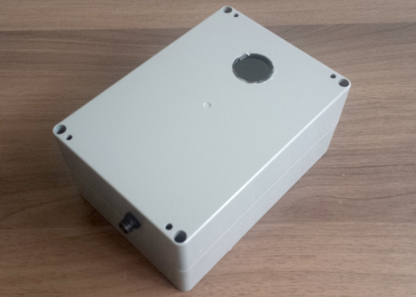 Finished weatherproof box with lens for an IR distance sensor